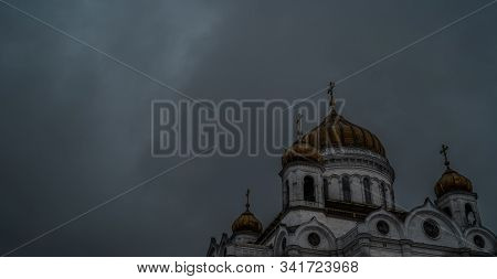 Golden Domes Of A Christian Temple In Russia Against The Gray Sky. The Church Of The Christian Churc