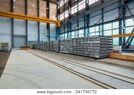 A Line For The Production Of Hollow Floor Slabs With An Overhead Crane And Folded New Slabs.