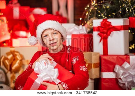 Intrigued Cute Santa. Child Little Happy Boy Find Gifts Near Christmas Tree. Gifts Shop. Kid Santa H