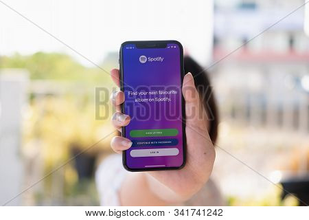 Chiang Mai ,thailand Dec 12 2019 : Woman Hand Holding Iphone Xs With Spotify Login Screen. Spotify I