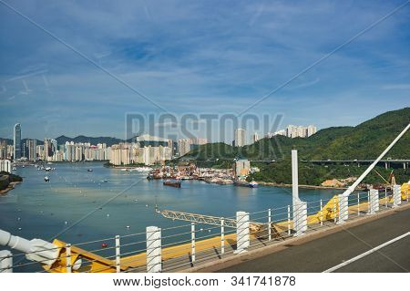 HONG KONG, CHINA - JUNE 18, 2015: view seen from second desk of a double decker bus in Hong Kong in the daytime. Ting Kau Bridge is a long cable-stayed bridge in Hong Kong.