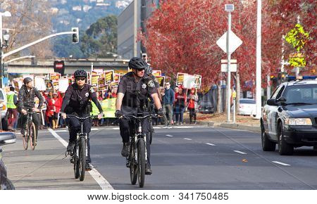 Oakland, Ca - Dec 17, 2019: Oakland Police Provide Escort And Traffic Control For Kaiser Mental Heal