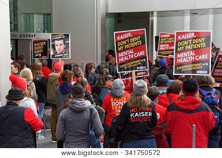 Oakland, Ca - Dec 17, 2019: Unidentified Health Care Workers Protesting Outside Kaiser Medical Cente