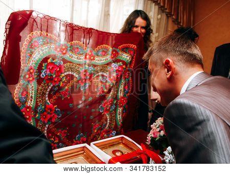 Lutsk, Volyn / Ukraine - August 30 2008: Groom During Redemption Of Bride On Wedding At Home