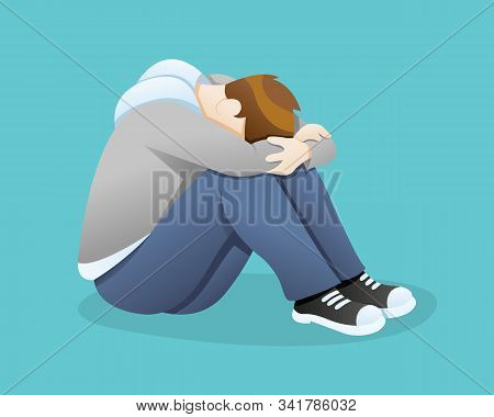 Depressed Man Feeling Sadness. Despaired Man Hug His Knee And Cry When Sitting Alone, Sad Boy Sittin