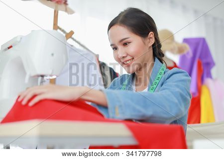 Beautiful Young Female Fashion Designer Start Sewing Her New Dress. She Is Happy With Her Started A
