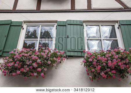 Beautiful Windows Frame With Flower Boxes. Geranium Or Cranesbill In A Window Box. Rural Window Fram