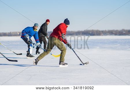 Dnipro, Ukraine - January 22, 2017: Group Of Different Ages Ordinary People Playing Hockey On A Dnip