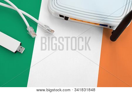 Ireland Flag Depicted On Table With Internet Rj45 Cable, Wireless Usb Wifi Adapter And Router. Inter