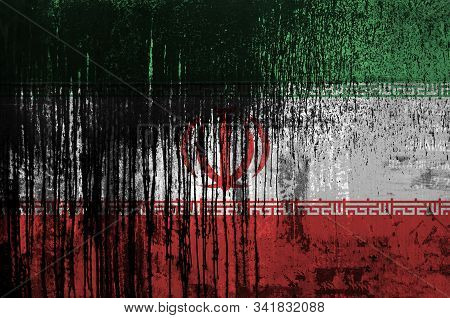Iran Flag Depicted In Paint Colors On Old And Dirty Oil Barrel Wall Closeup. Textured Banner On Roug