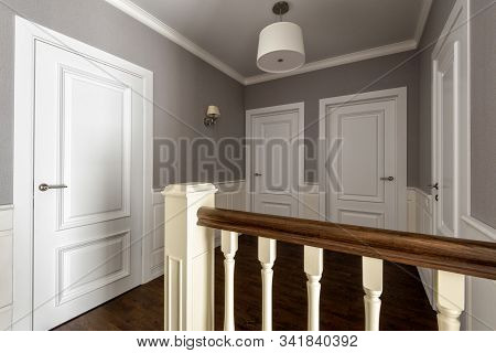 Interior Of Residential House. Hallway Of Second Floor With Several White Doors. Home Interior Desig