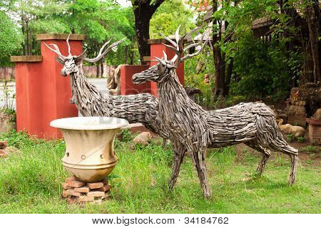 two deer made from pieces of wood