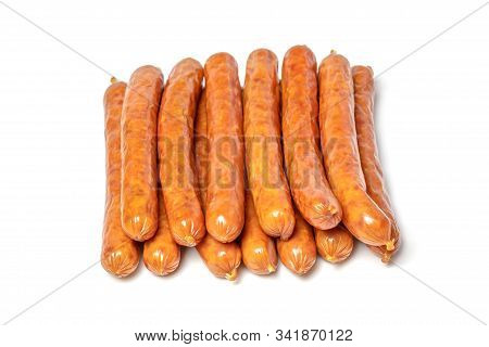 Dried Pork Sausages On A White Plate, Isolate. Sausages, Dry Smoked Sausages, Hunting Sausages, Kaba