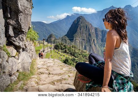 Tourist Contemplating The Beautiful Landscape Of Machu Picchu. At The Bottom You Can See The Mountai