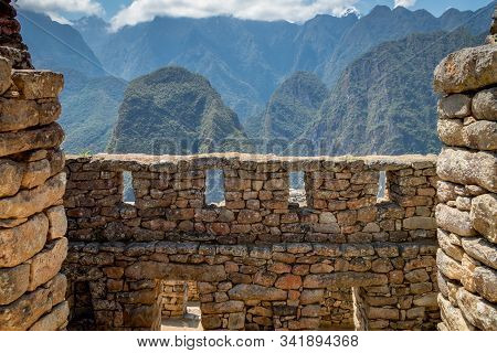 Machu Picchu Shot Taken Fron The Inside Of A Ruin Where Big Walls Made Of Stones And Windows Can Be
