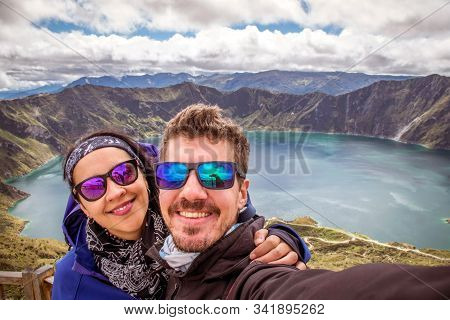 Couple Of Turists Taking A Selfie In The Quilotoa Lagoon. Ecuador, South America