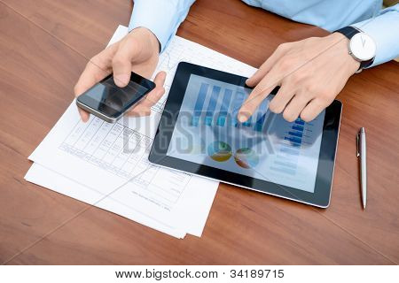 Man Working With Modern Devices