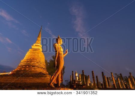 Ancient Buddha Image With Pagoda In Ruin Buddhist Temple At Twilight In Sukhothai Historical World H