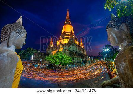 Unidentified Buddhists Making Candle Light Procession Around The Pagoda  In Wat Yai Chaimongkon, The