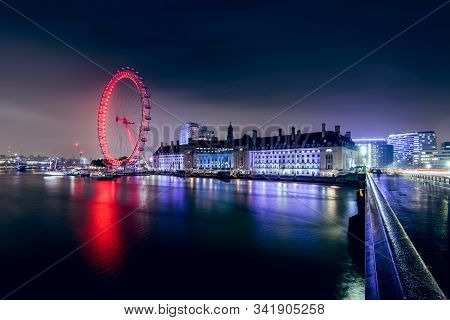 London, Uk - November 21, 2019: View Of The London Eye At Night - A Famous Tourist Attraction Over R