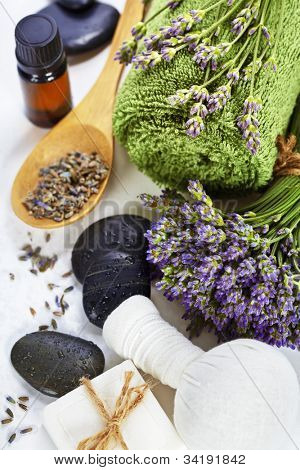 lavender spa (fresh lavender flowers,  essential oil, salt,  Herbal massage balls, zen stones) over white