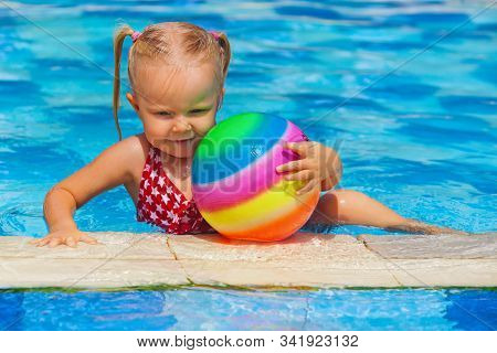 Happy Family In Swimming Pool. Smiling Child Swim, Dive In Pool With Fun, Play Active Games With Bal