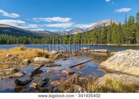 View Of Finch Lake And Rocky Mountains In Background