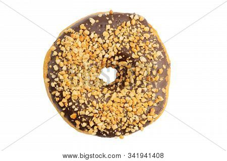 Closeup Chocolate Covered Donut And Sprinkled With Grated Nuts Isolated On White. Top View.