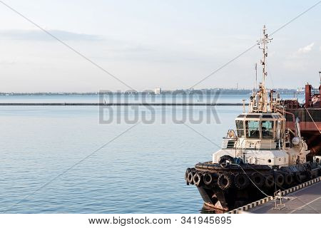Colored Tugboat Works In Port. Bright Tugboat In Blue Water. Industrial Ship On Waves Tropical Islan