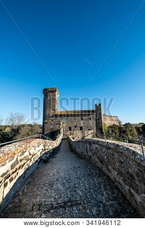 Vulci, Italy - December 26, 2019: The Badia Bridge And Castle, Medieval Dating Back To The 13th Cent