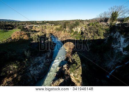 Vulci, Italy - December 26, 2019: The Shadow Of Badia Bridge, Medieval Dating Back To The 13th Centu