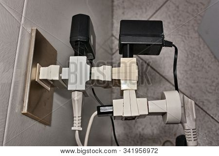 Bunch Of Adapters And Plugs On Electrical Socket - Bad Electrical Connection - Overloaded Electric T