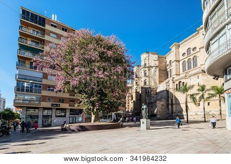 Malaga, Spain - December 4, 2018: Cardenal Herrera Oria Statue On The Cortina Del Muelle Street (cal