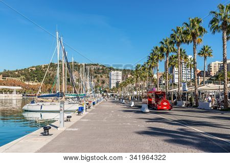 Malaga, Spain - December 4, 2018: Yachts And People At The Paseo Del Muelle Uno (pier One Walk), A B