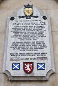 Sir William Wallace memorial plaque on the wall of St.Bartholomews Hospital in Smithfield London - the location of his execution in 1305. poster