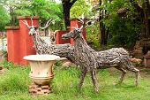 two deer made from pieces of wood. poster