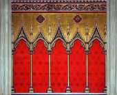 Wall decoration with gothic and floral motives painted in red blue and gold colors poster
