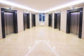 Modern Clean Elevator Hall Of Apartment Buidling. Marble Floor, No People.