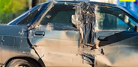 Damaged And Smashed Car After Incident On Road Left At Parking Lot And Waiting For Repair Or Utilisa