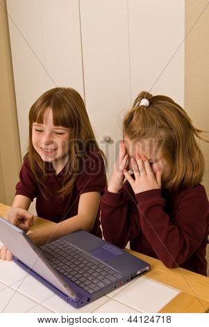 Young girls working on a laptop computer