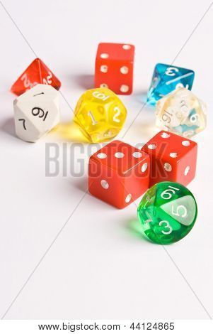 Multicolored role play dice isolated on white