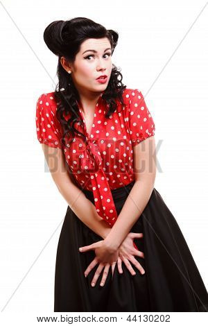 Beautiful young woman with pin-up make-up and hairstyle posing in studio poster