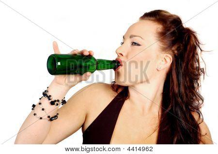 Attractive Brunette Drinking A Bottle Of Beer