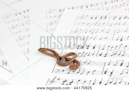 Treble clef on musical background