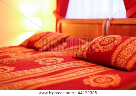 Pillows And Double Bed In Interior Of Modern Hotel