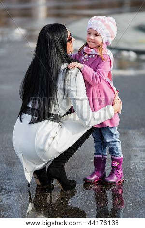 Brunette Woman And Young Girl