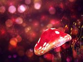 Big mushroom on glowing purple fantasy bokeh background. poster