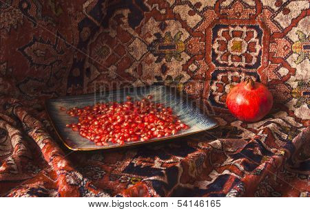 Still Life with Pomegranate and Armenian carpet with daylight poster