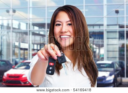 Beautiful young woman with a car keys.