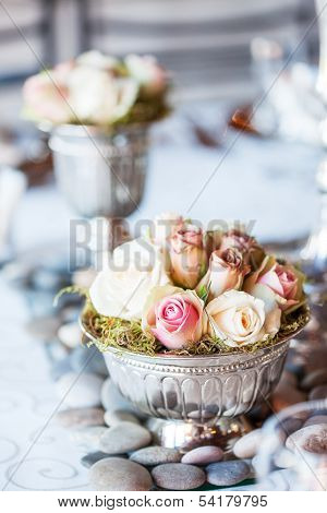 Small Bouquet Of Roses On Table At Wedding